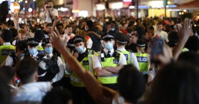 two police officers injured in clashes with soccer fans in london